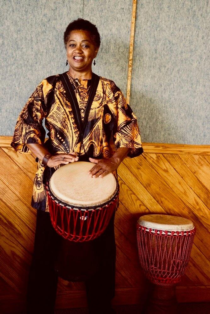 Deborah Peyton playing djembe